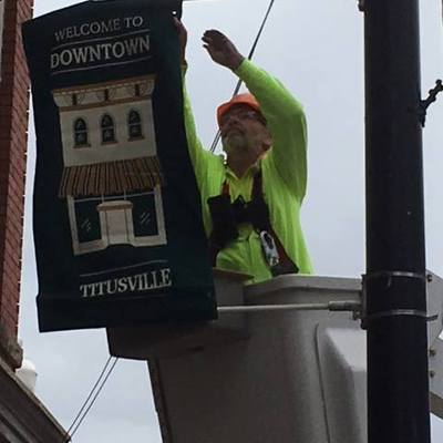 The Downtown Banner Program is facilitated by TRI with hanging help by Armstrong.