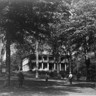Exterior of the museum circa late 19th century showing established landscaping and grounds