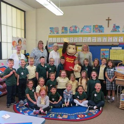 Curious George visits schools to promote reading