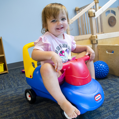 Toddler utilizing indoor gross motor equipment at our Willow CDC